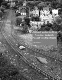 Old black and white films/ Nefarious dastardly/ Plan set with train tracks -Kel Dayheart